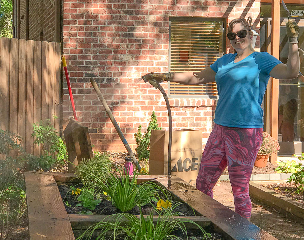 Volunteer Sarah beautifying our property at West Jones St. in Raleigh