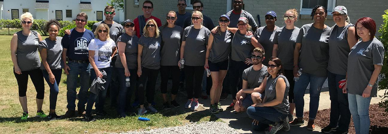 team of volunteers helping improve a casa knightdale community